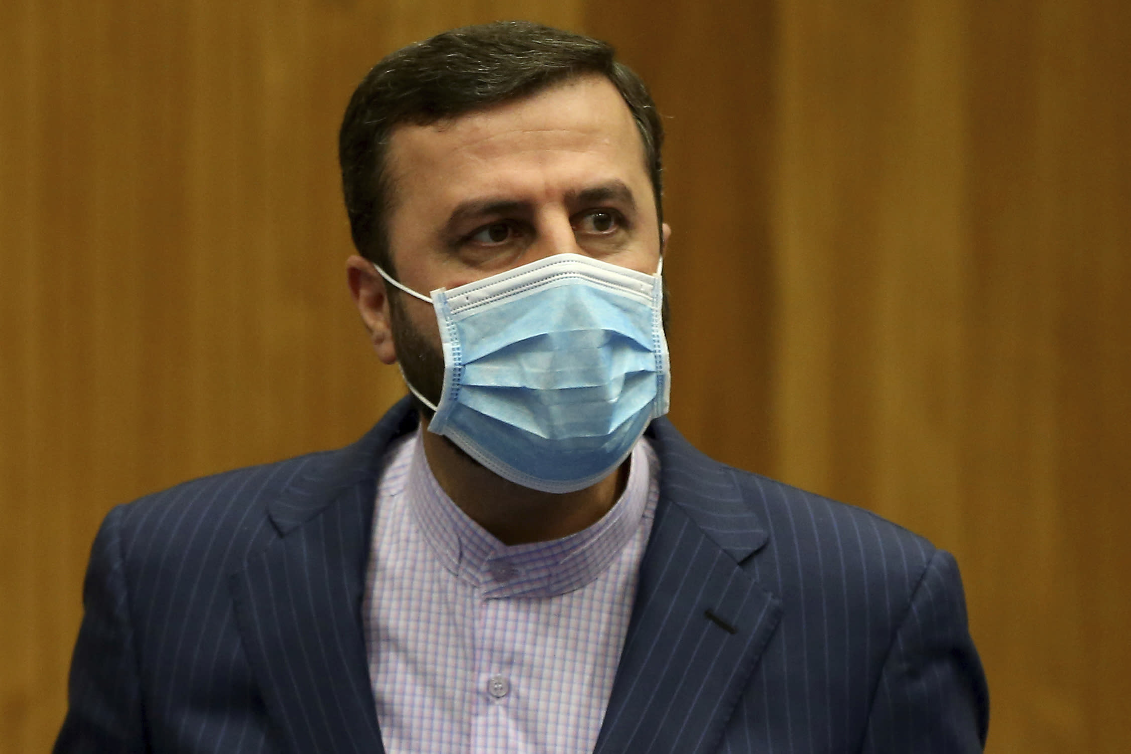 Iran's Ambassador to the International Atomic Energy Agency, IAEA, Kazem Gharibabadi with face mask arrives for the start of the IAEA board of governors meeting at the International Center in Vienna, Austria, Monday, Sept. 14, 2020. (AP Photo/Ronald Zak)