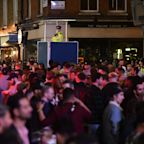 Crowds fill the streets and social distancing disappears as pubs open on Super Saturday