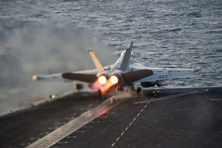 An EA-18G Growler launches from the Nimitz-class aircraft carrier USS Carl Vinson in the Arabian Gulf