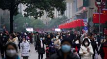 Beijing, Shanghai urge people from virus outbreak areas to stay at home for 14 days