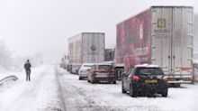 Widespread disruption as parts of Britain blanketed in snow