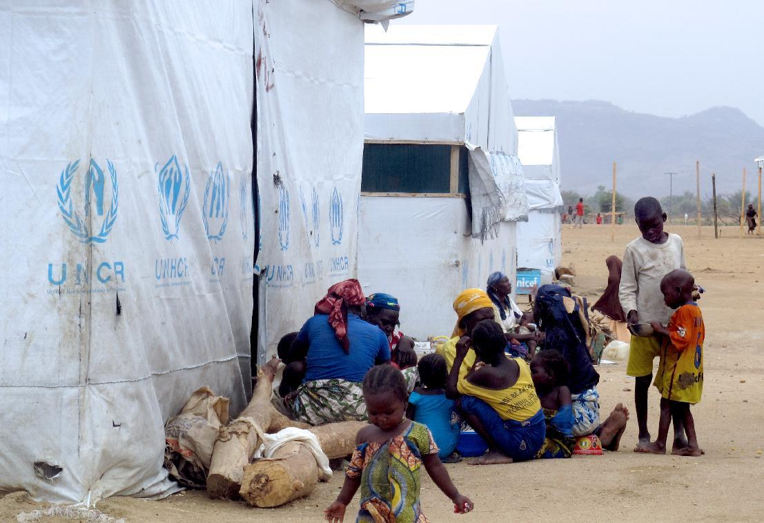 Nigerian refugees sit by a United Nation Refugee Agency tent in the Minawao camp in Cameroon, March 29, 2014 (AFP Photo/Reinnier Kaze)