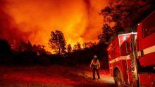 US homes destroyed as firefighters battle wildfires under orange skies