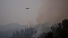 California wine country firefight intensifies, progress made in deadly Cascades blaze