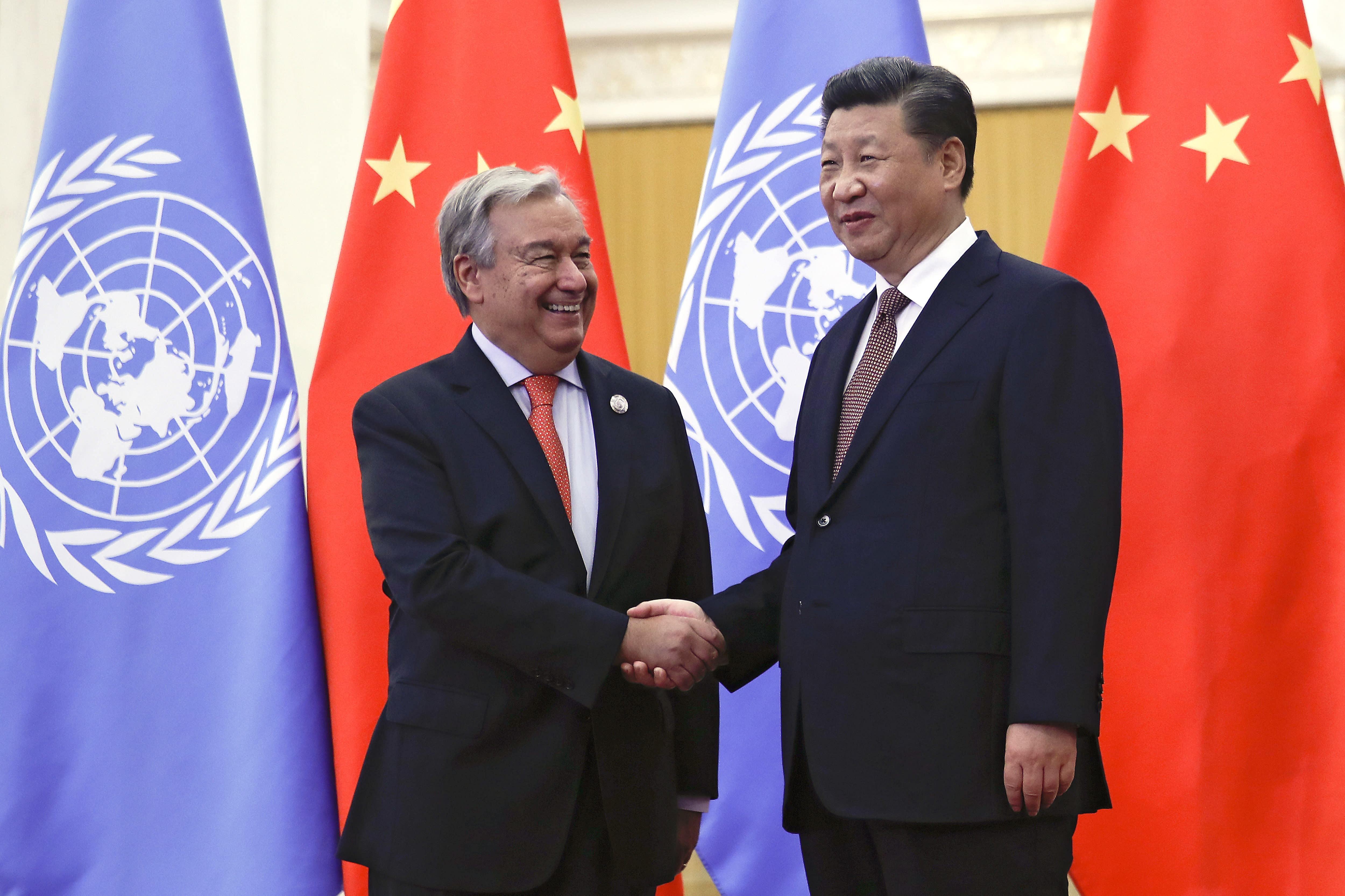 "FILE - In this Sept. 2, 2018 file photo, United Nations Secretary-General Antonio Guterres, left, shakes hands with Chinese President Xi Jinping before their bilateral meeting at the Great Hall of the People in Beijing. The descriptions that China's state media rolled out ahead of leader Xi's speech Tuesday, Sept. 22, 2020, at the annual gathering of world leaders at the United Nations lauded him as as a ""champion of the U.N. ethos,"" and commentaries laid out his expectations and plans as he prepared for virtual meetings with his colleagues at the U.N. General Assembly. (AP Photo/Andy Wong, Pool, File)"