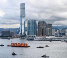 Asian markets gain after Wall Street caps impressive quarter