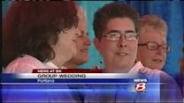 Same-sex couples tie knot in mass wedding