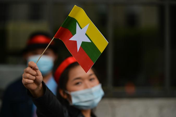 A member of the local Myanmar (Burmese) diaspora holding a national flag of Myanmar seen in front of the GPO in Dublin at a pro-democracy rally called 'Global Spring Revolution' for Myanmar.  On Saturday, June 12, 2021, in Dublin, Ireland. (Photo by Artur Widak/NurPhoto via Getty Images)