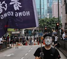 Beijing says it will unilaterally impose national laws in Hong Kong 'without delay' as thousands take to the streets in protest