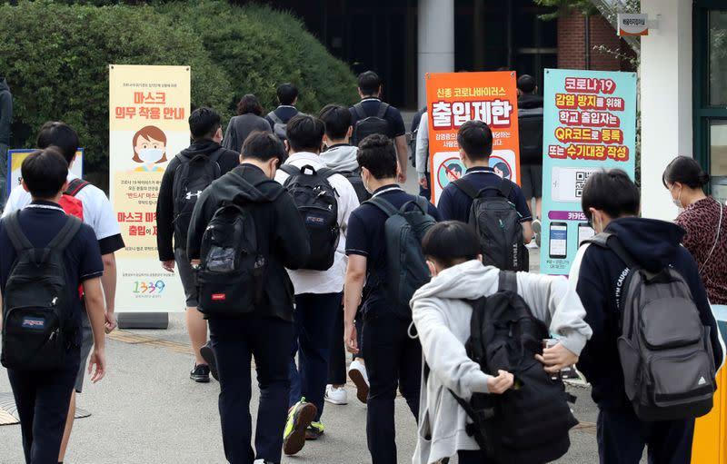 High school students arrive at a high school, amid the coronavirus disease (COVID-19) pandemic, in Seoul