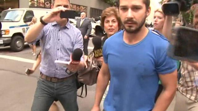 Shia LaBeouf surrounded by reporters after leaving Manhattan court