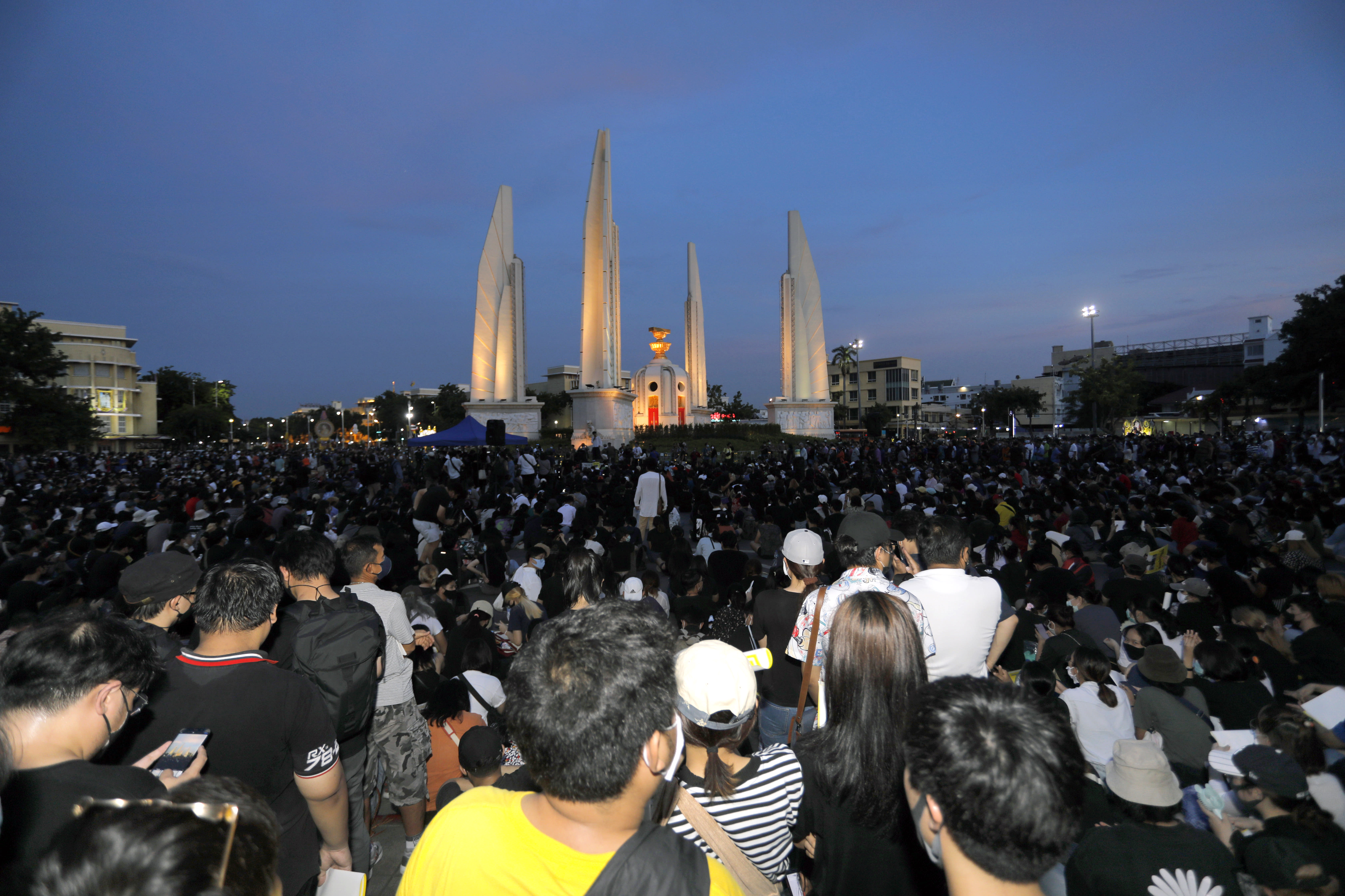 Thai anti-government protesters gather front of the Democracy Monument in Bangkok, Thailand, Saturday, July 18, 2020. Several thousand anti-government protesters have rallied in the Thai capital Bangkok to call for a new constitution, new elections and an end to repressive laws. (AP Photo/Nathathida Adireksarn)