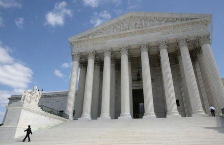 Security guards walk the steps of the Supreme Court in Washington