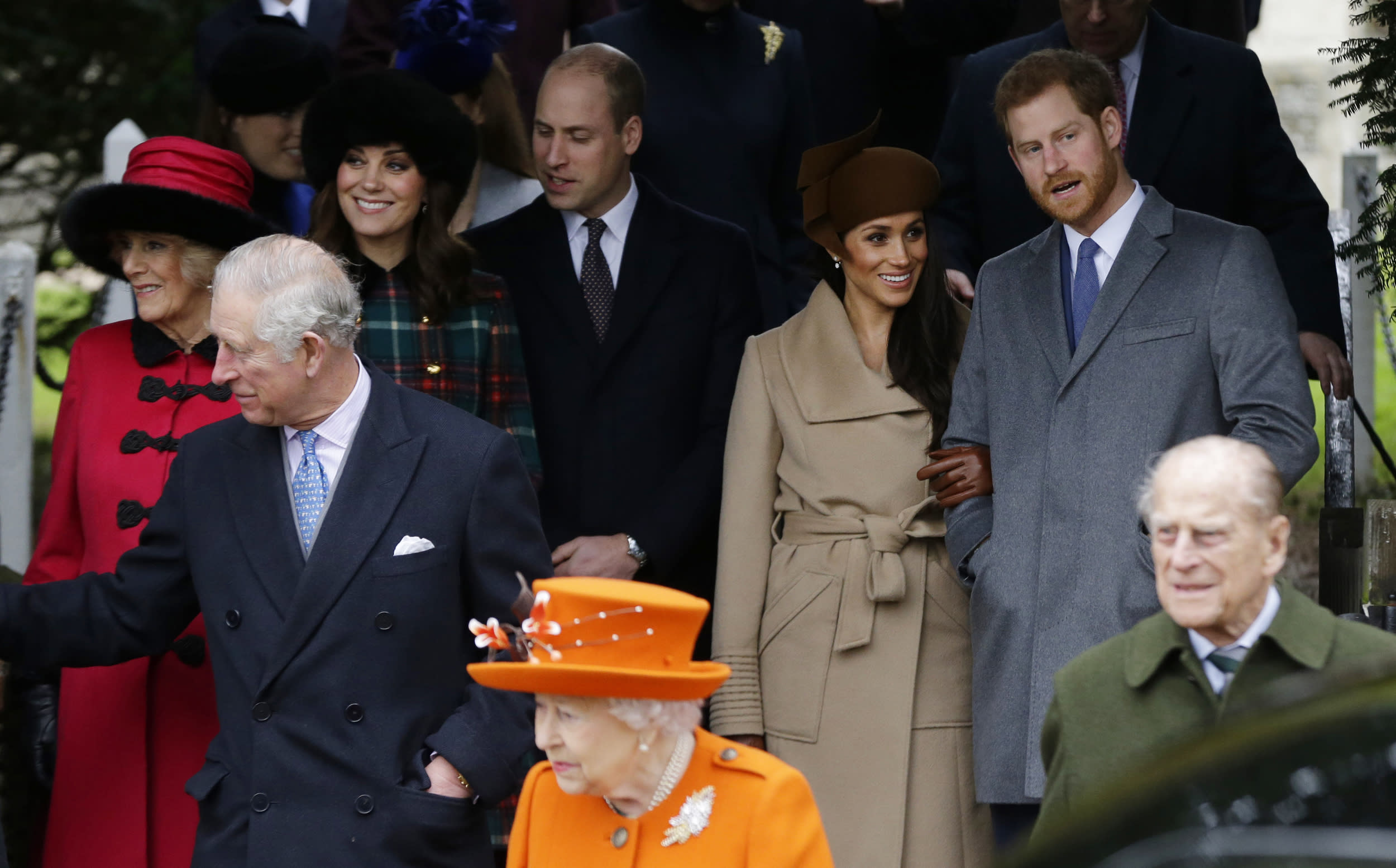 Front from left: Prince Charles, Queen Elizabeth II and Prince Philip. Rear From left, Camilla, Duchess of Cornwall, Kate, Duchess of Cambridge, Price William, Meghan Markle, and her fiancee Prince Harry, right, as they wait for the Queen to leave by car following the traditional Christmas Day church service, at St. Mary Magdalene Church in Sandringham, England, Monday, Dec. 25, 2017. (AP Photo/Alastair Grant)