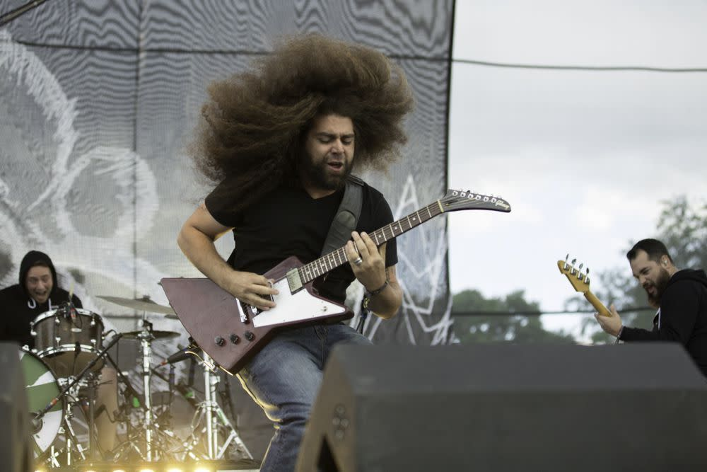 Fooled us! Coheed and Cambria's Claudio Sanchez didn't cut off his long mane of hair after all