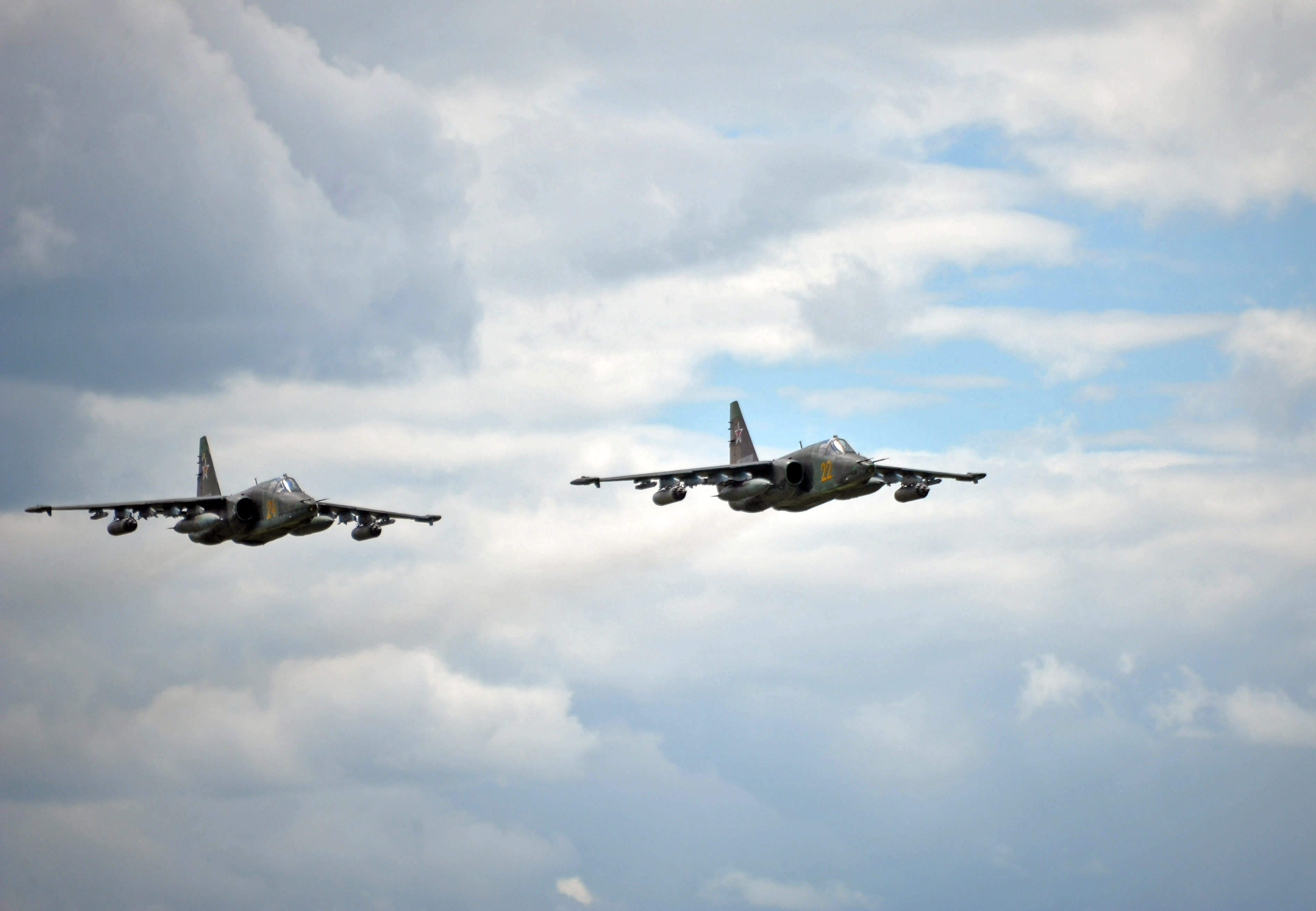 Russian Army Su-25 jet fighters fly near the Baikal Lake in Russis on Wednesday, July 17, 2013. Russia has launched its biggest military maneuvers since Soviet times, involving 160,000 troops and about 5,000 tanks across Siberia and the far eastern region. (AP Photo/RIA Novosti, Alexei Nikolsky, Presidential Press Service)
