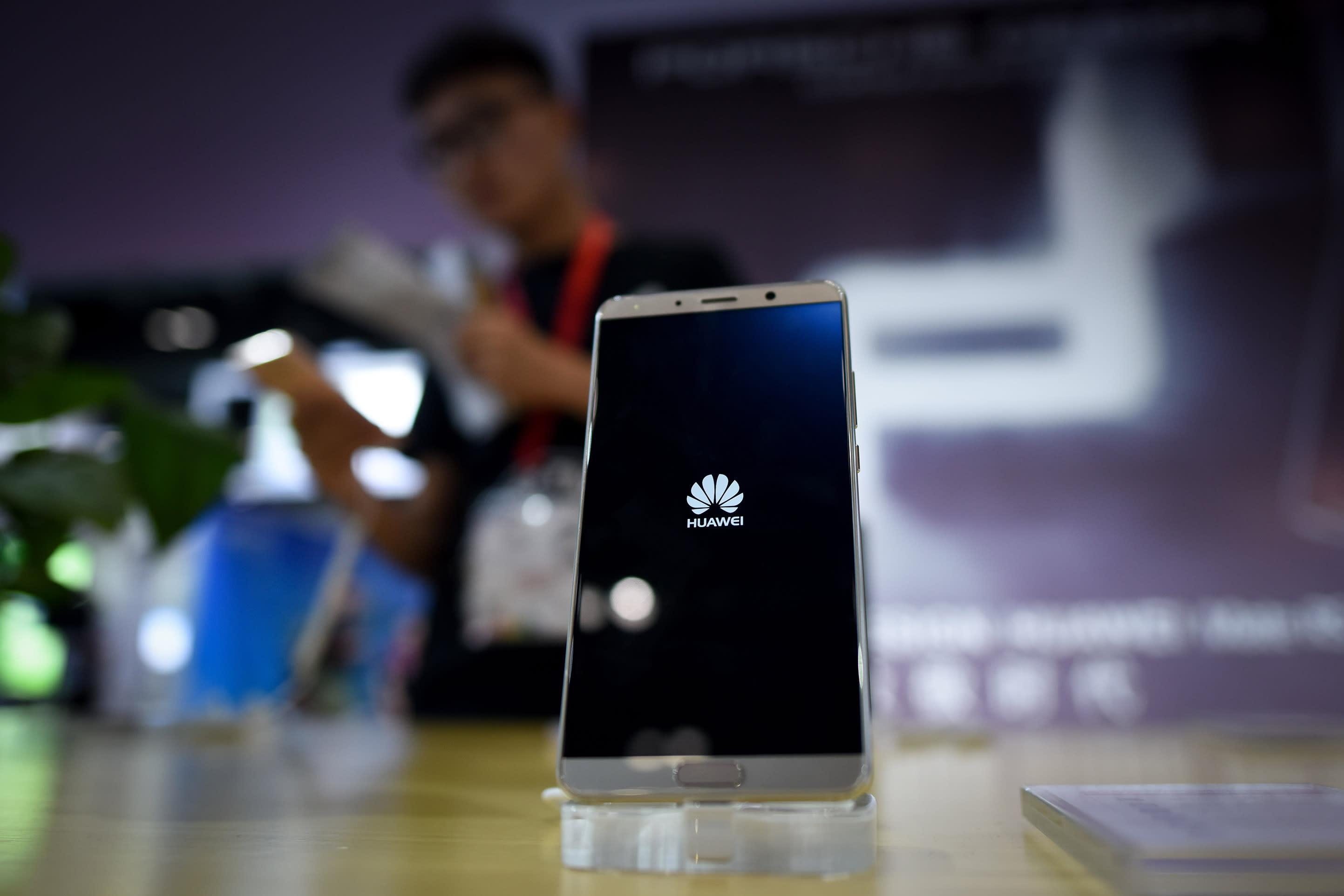 Japanese, UK carriers delay release of Huawei phones