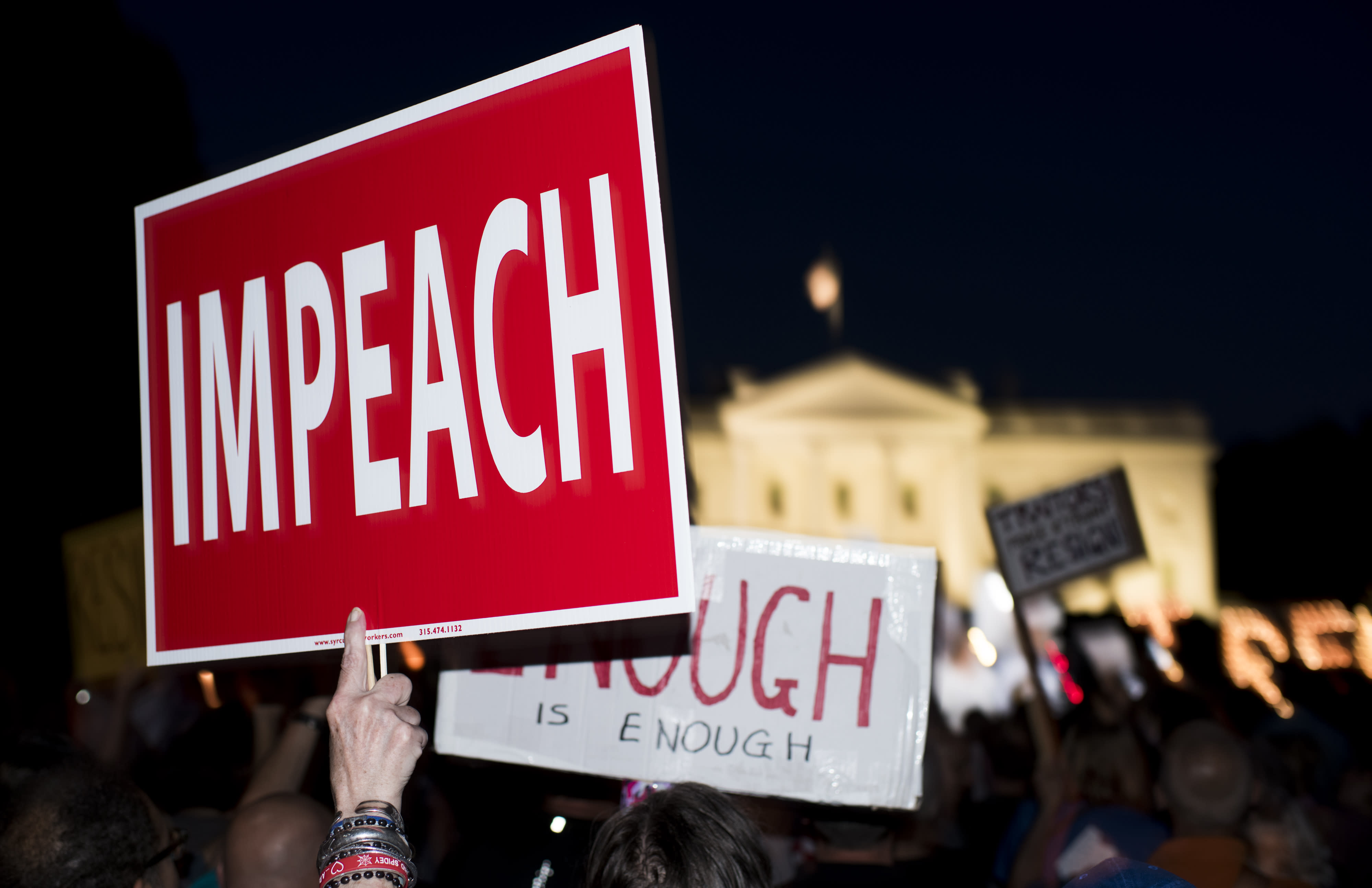 <p>Protesters gather in front of the White House for a rally and candlelight vigil on July 18, 2018. The protest was one of more than 100 events around the country following 12 new indictments in special counsel Robert Mueller's Russia probe and President Trump's comments in Helsinki during the summit with Russian President Vladimir Putin. (Photo: Bill Clark/CQ Roll Call/Getty Images) </p>