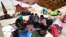 Cerca de 400 bolivianos y peruanos acampan en dos límites fronterizos de Chile