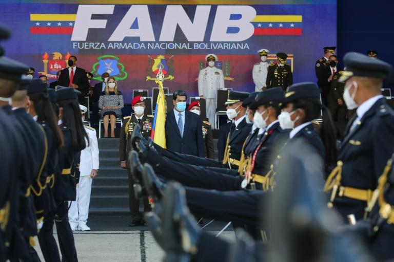 Venezuela President Nicolas Maduro (center) takes part in a ceremony to hand out promotions to military officers