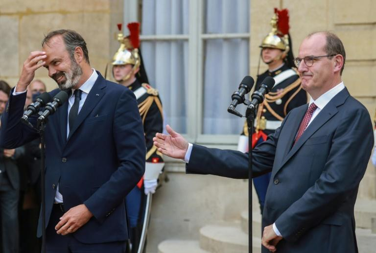 Edouard Philippe, left, hands over to Jean Castex, whom few had ever heard of (AFP Photo/Ludovic Marin)