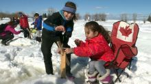 Syrian refugees learn how to ice fish