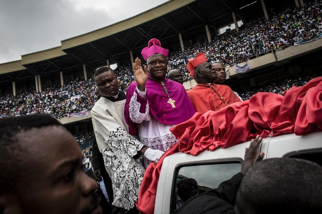 Kinshasa's new archbishop, Mgr Fridolin Ambongo, urged voters to cast their ballot in the name of national unity and reject violence (AFP Photo/John WESSELS)