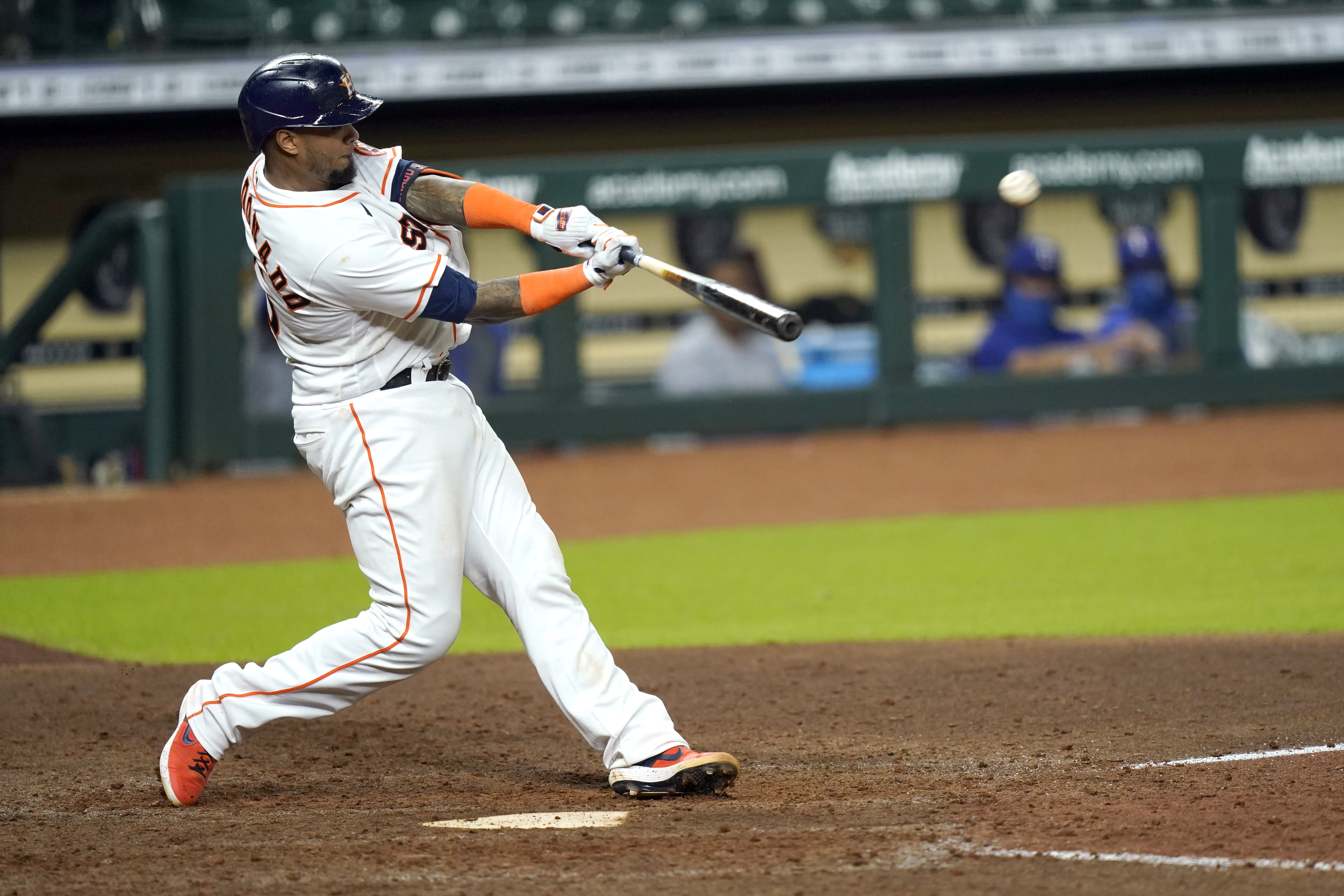Houston Astros' Martin Maldonado hits a home run against the Texas Rangers during the eighth inning of a baseball game Tuesday, Sept. 15, 2020, in Houston. (AP Photo/David J. Phillip)