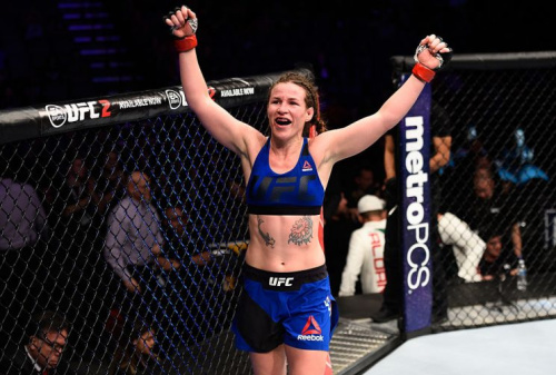 Leslie Smith raises her hands after facing Irene Aldana in their women's bantamweight bout during a UFC Fight Night event on December 17, 2016. (Getty)