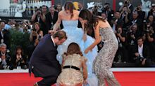 Natalie Portman rescues co-star from wardrobe malfunction on Venice Film Festival red carpet