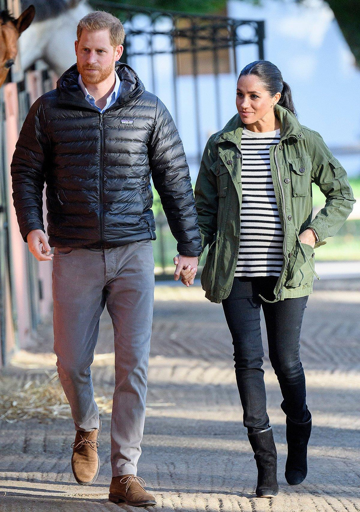 """Meghan and Harry visited the Moroccan Royal Federation of Equestrian Sports to learn about the country's program of supporting children with special needs through animal therapy. Meghan wore a <a href=""""https://people.com/royals/meghan-markle-rewears-jacket-pre-royalty-days/"""" rel=""""nofollow noopener"""" target=""""_blank"""" data-ylk=""""slk:recycled J.Crew anorak jacket"""" class=""""link rapid-noclick-resp"""">recycled J.Crew anorak jacket</a> over a striped sweater with black pants and <a href=""""http://www.anrdoezrs.net/links/8029122/type/dlg/sid/PEO,Shopping:EverythingYouNeedtoCopyMeghanMarkle'sChicSpringStyle,kamiphillips2,Unc,Gal,6939680,201905,I/https://www.stuartweitzman.com/womens-shoes/boots/"""" rel=""""nofollow noopener"""" target=""""_blank"""" data-ylk=""""slk:Stuart Weitzman"""" class=""""link rapid-noclick-resp"""">Stuart Weitzman</a> booties for a look that was equally cute and casual. <strong>Get the Look!</strong> Everlane The Modern Utility Jacket, $78; <a href=""""http://www.pntra.com/t/8-9711-131940-104709?sid=PEO%2CShopping%3AEverythingYouNeedtoCopyMeghanMarkle%27sChicSpringStyle%2Ckamiphillips2%2CUnc%2CGal%2C6939680%2C201905%2CI&url=https%3A%2F%2Fwww.everlane.com%2Fproducts%2Fwomens-modern-utlty-jkt-surplus"""" rel=""""nofollow noopener"""" target=""""_blank"""" data-ylk=""""slk:everlane.com"""" class=""""link rapid-noclick-resp"""">everlane.com</a> Sanctuary Commodore Hooded Anorak, $169; <a href=""""https://click.linksynergy.com/deeplink?id=93xLBvPhAeE&mid=13867&murl=https%3A%2F%2Fwww.bloomingdales.com%2Fshop%2Fproduct%2Fsanctuary-commodore-hooded-anorak%3FID%3D3207506&u1=PEO%2CShopping%3AEverythingYouNeedtoCopyMeghanMarkle%27sChicSpringStyle%2Ckamiphillips2%2CUnc%2CGal%2C6939680%2C201905%2CI"""" rel=""""nofollow noopener"""" target=""""_blank"""" data-ylk=""""slk:bloomingdales.com"""" class=""""link rapid-noclick-resp"""">bloomingdales.com</a> DL1961 Women's Beekman Military Jacket, $168; <a href=""""https://www.amazon.com/DL1961-Womens-Beekman-Military-X-Small/dp/B077KHG14C?ie=UTF8&camp=1789&creative=9325&linkCode=as2&creativeASIN=B077KHG14C&tag=peop"""