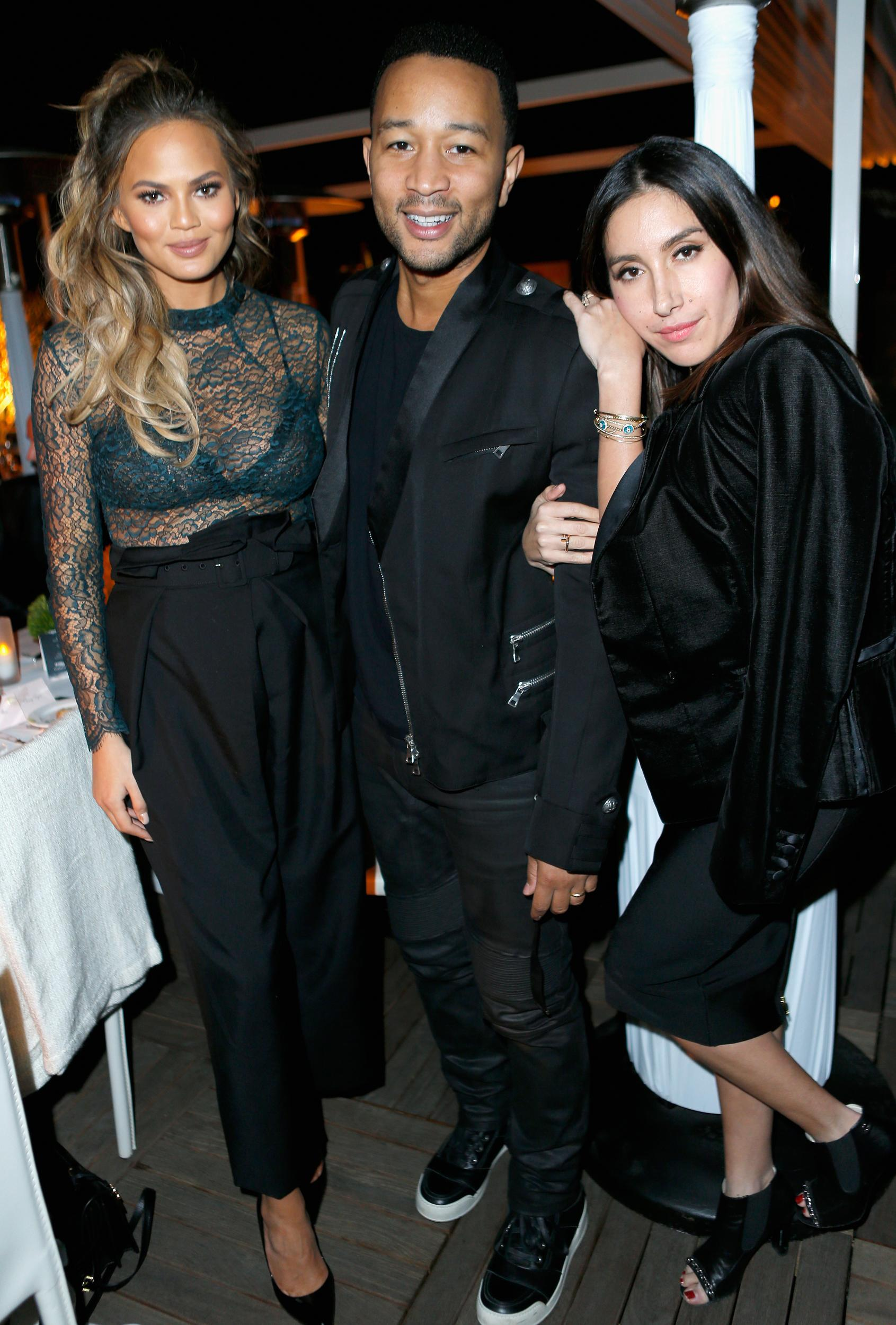 WEST HOLLYWOOD, CA - NOVEMBER 11: (L-R) Model Chrissy Teigen, recording artist John Legend and  hairstylist Jen Atkin attend The Hollywood Reporter's Beauty Dinner at The London West Hollywood on November 11, 2015 in West Hollywood, California.  (Photo by Jeff Vespa/Getty Images for The Hollywood Reporter)