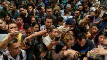 Venezuelans swarm outside Chilean consulate seeking new visa