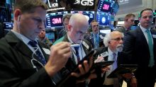Trade conflict looms but higher rates, oil prices help some stocks