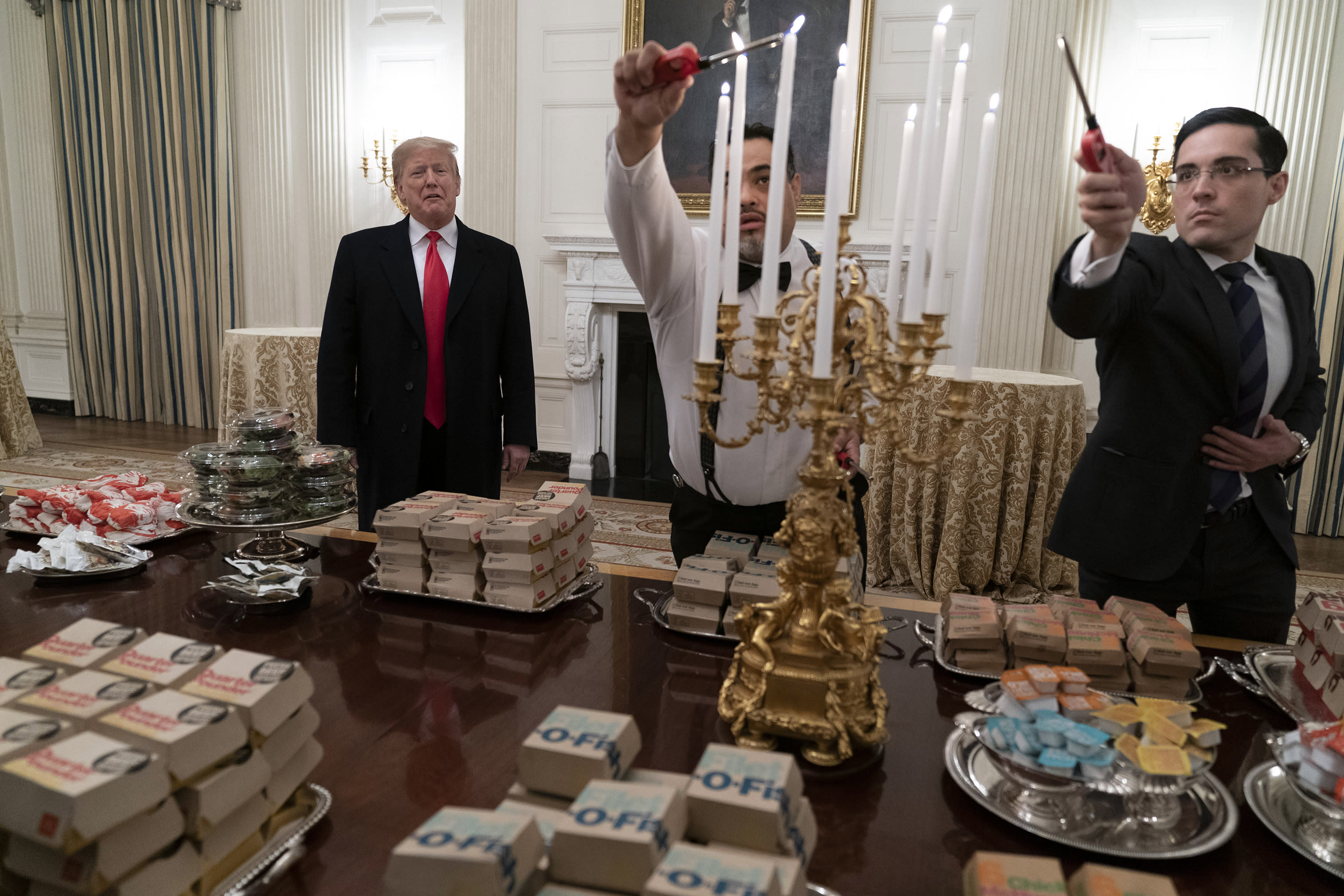 President Trump serves fast food to Clemson in bizarre White House visit