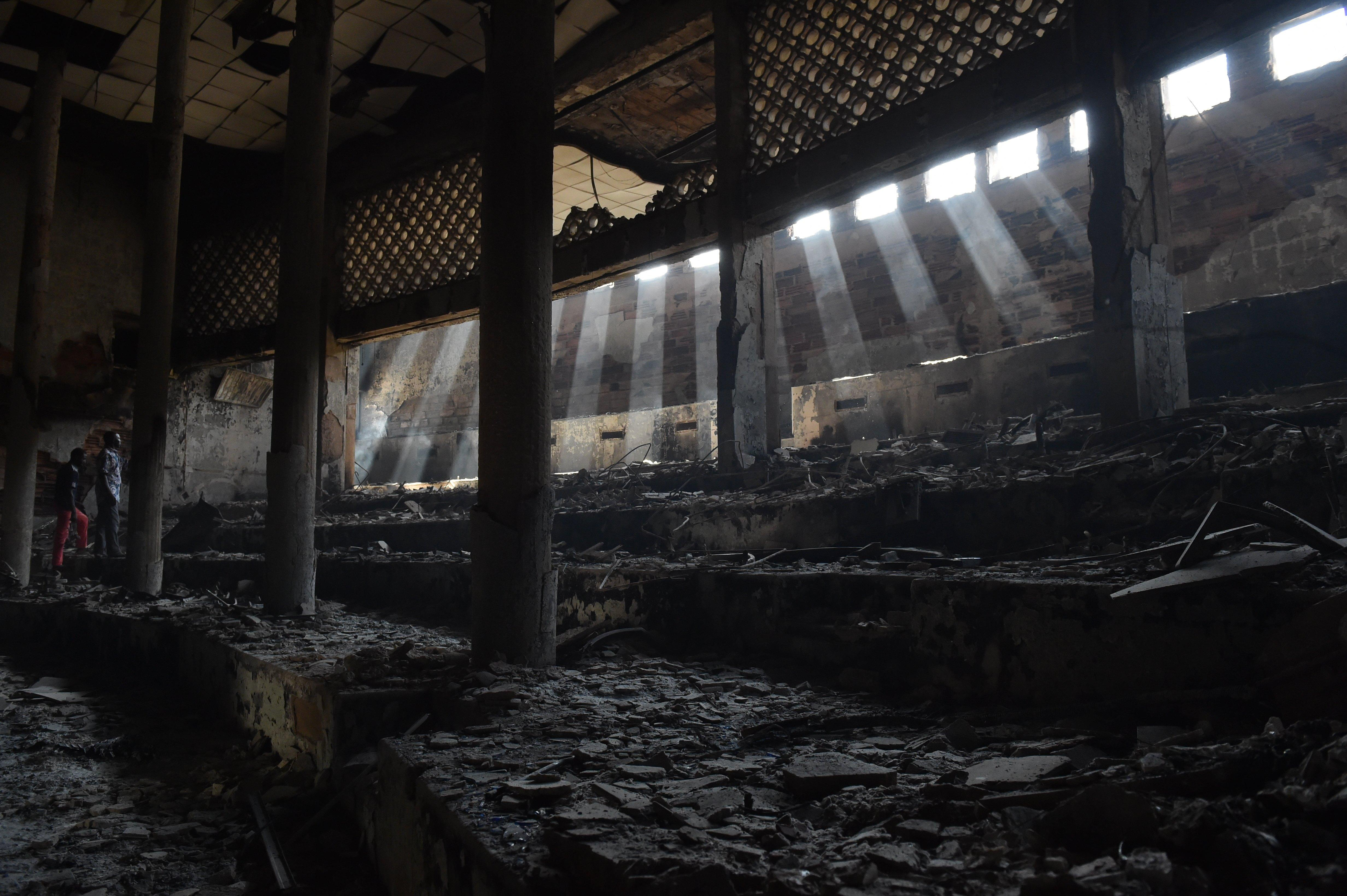 The burnt inside of the parliament in Ouagadougou pictured on October 31, 2014, a day after it was stormed by protesters (AFP Photo/Issouf Sanogo)