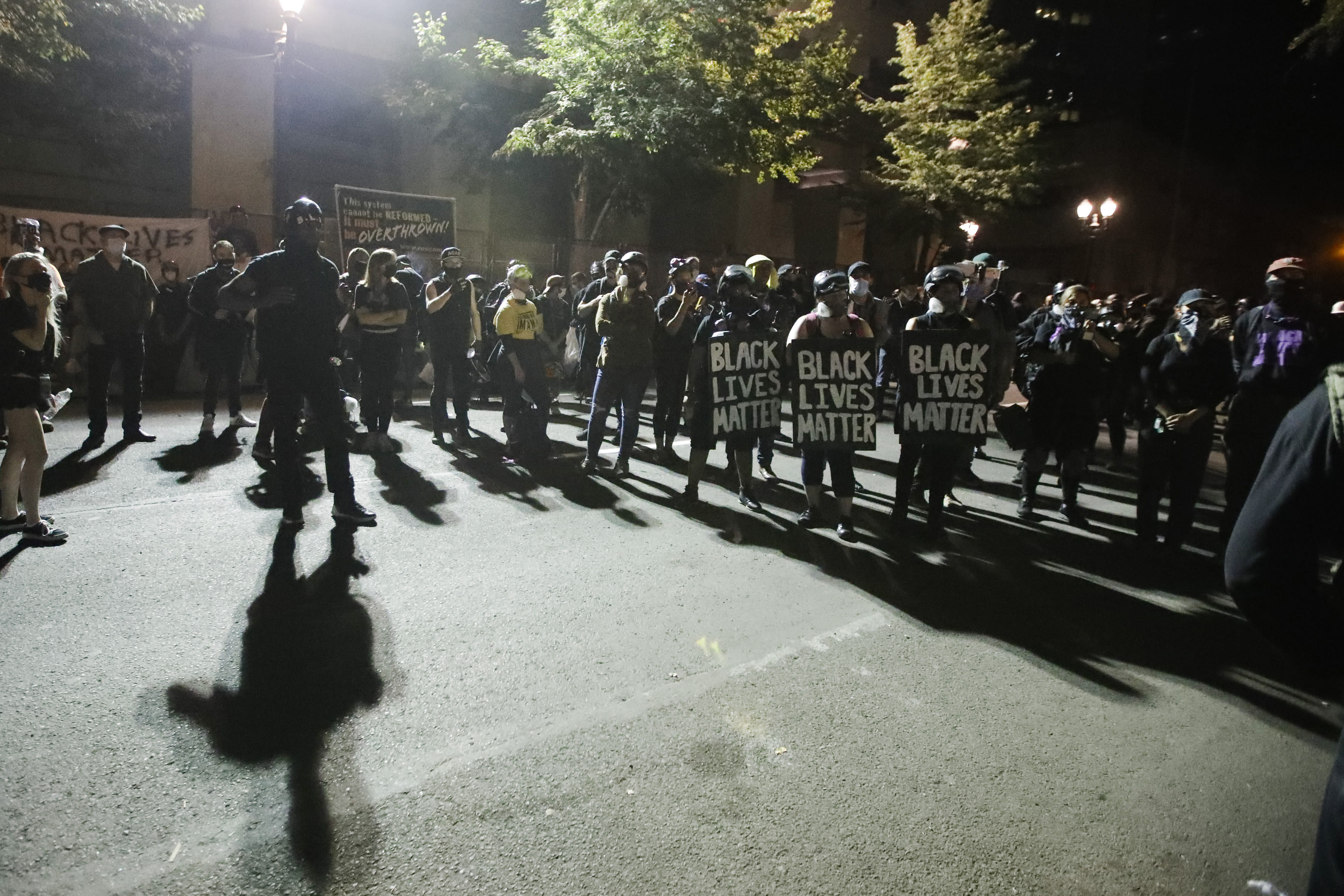 A crowd gathers during a Black Lives Matter protest at the Mark O. Hatfield United States Courthouse Thursday, July 30, 2020, in Portland, Ore. After days of clashes with federal police, the crowd outside of the federal courthouse remained peaceful Thursday night. (AP Photo/Marcio Jose Sanchez)