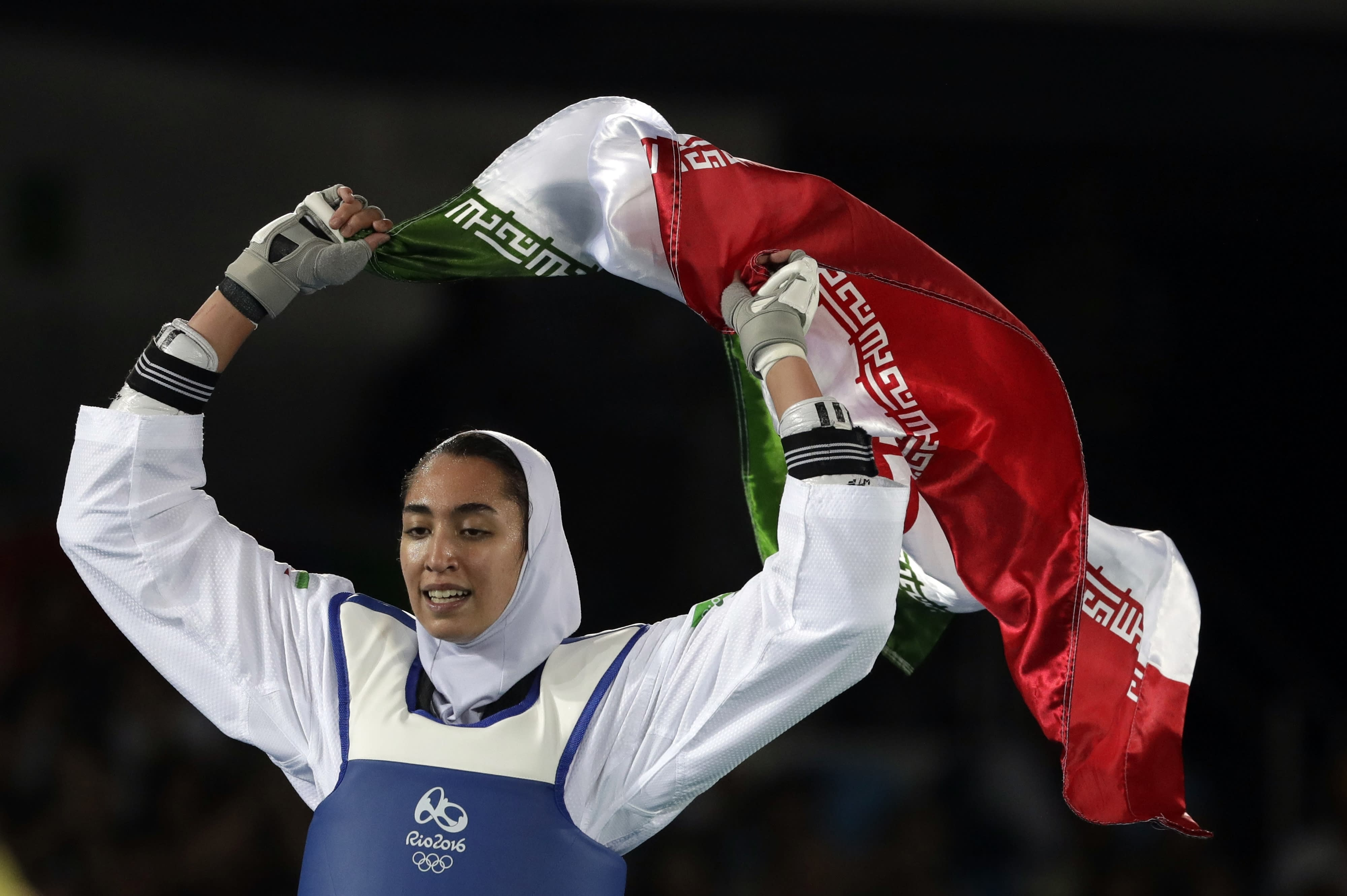 """FILE - In this Aug. 18, 2016 file photo, Kimia Alizadeh Zenoorin of Iran celebrates after winning the bronze medal in a women's Taekwondo 57-kg competition at the 2016 Summer Olympics in Rio de Janeiro, Brazil. Zenoorin, Iran's only female Olympic medalist, said she defected from the Islamic Republic in a blistering online letter that describes herself as """"one of the millions of oppressed women in Iran."""" (AP Photo/Andrew Medichini, File)"""
