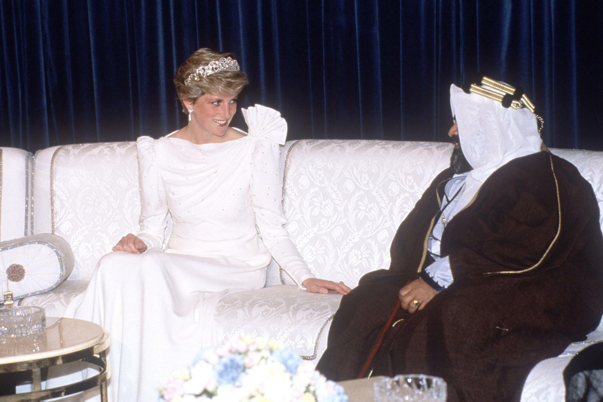 Diana dazzles in white frock and tiara during trip to the Middle East.