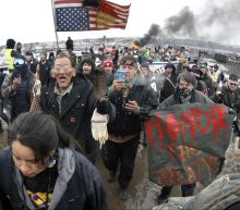 Lawsuit: North Dakota officers used 'violence' on protester
