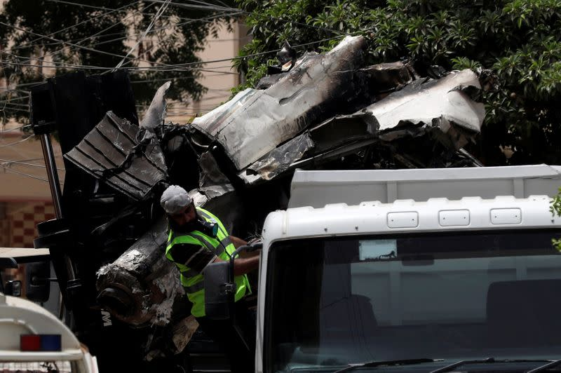A truck is loaded with the wreckage of the crashed plane, in Karachi