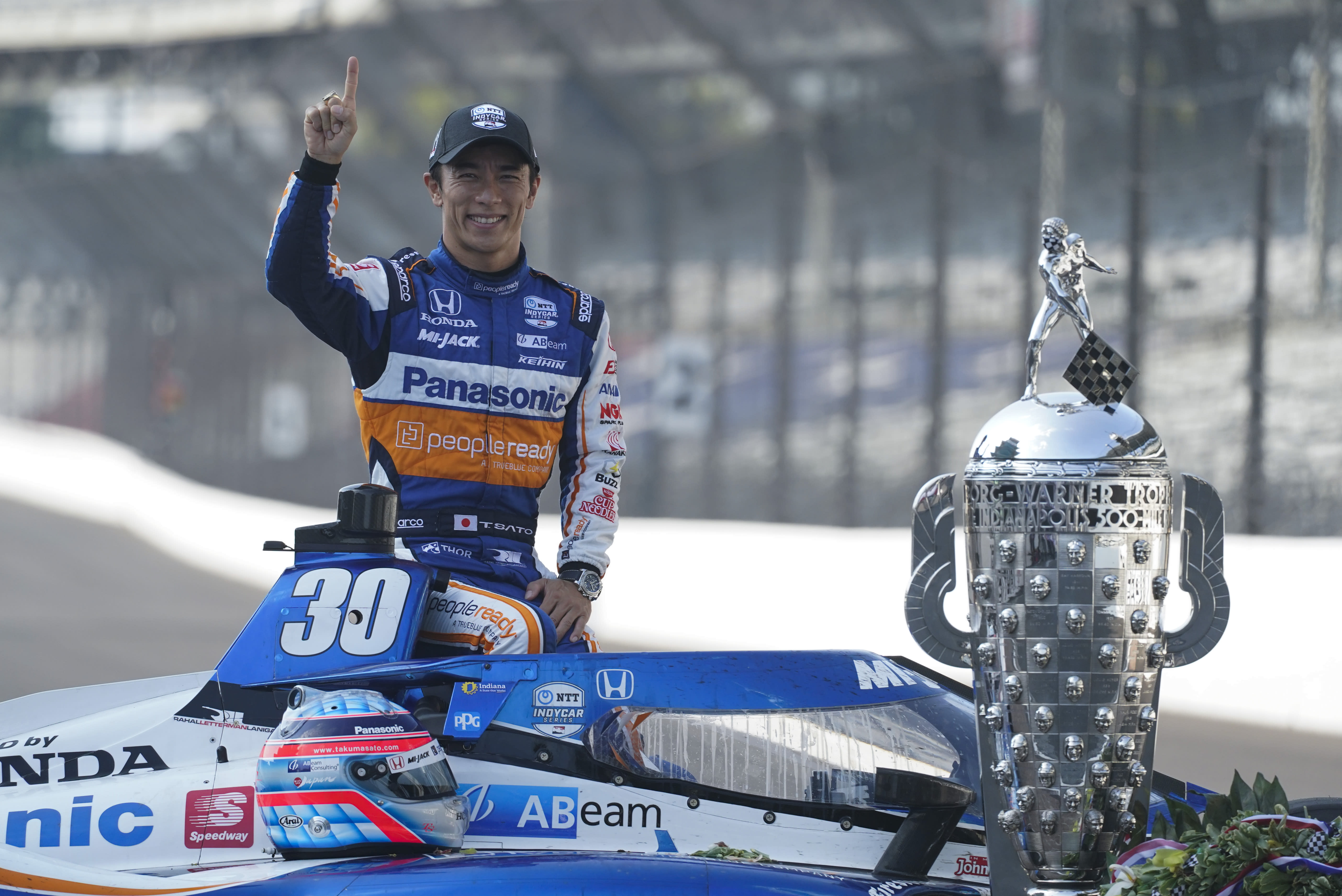 Takuma Sato, of Japan, winner of the 2020 Indianapolis 500 auto race, poses during the traditional winners photo session at the Indianapolis Motor Speedway, Monday, Aug. 24, 2020, in Indianapolis. (AP Photo/Darron Cummings)
