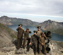 Politics, pride in leaders trip to 'sacred' N. Korea volcano