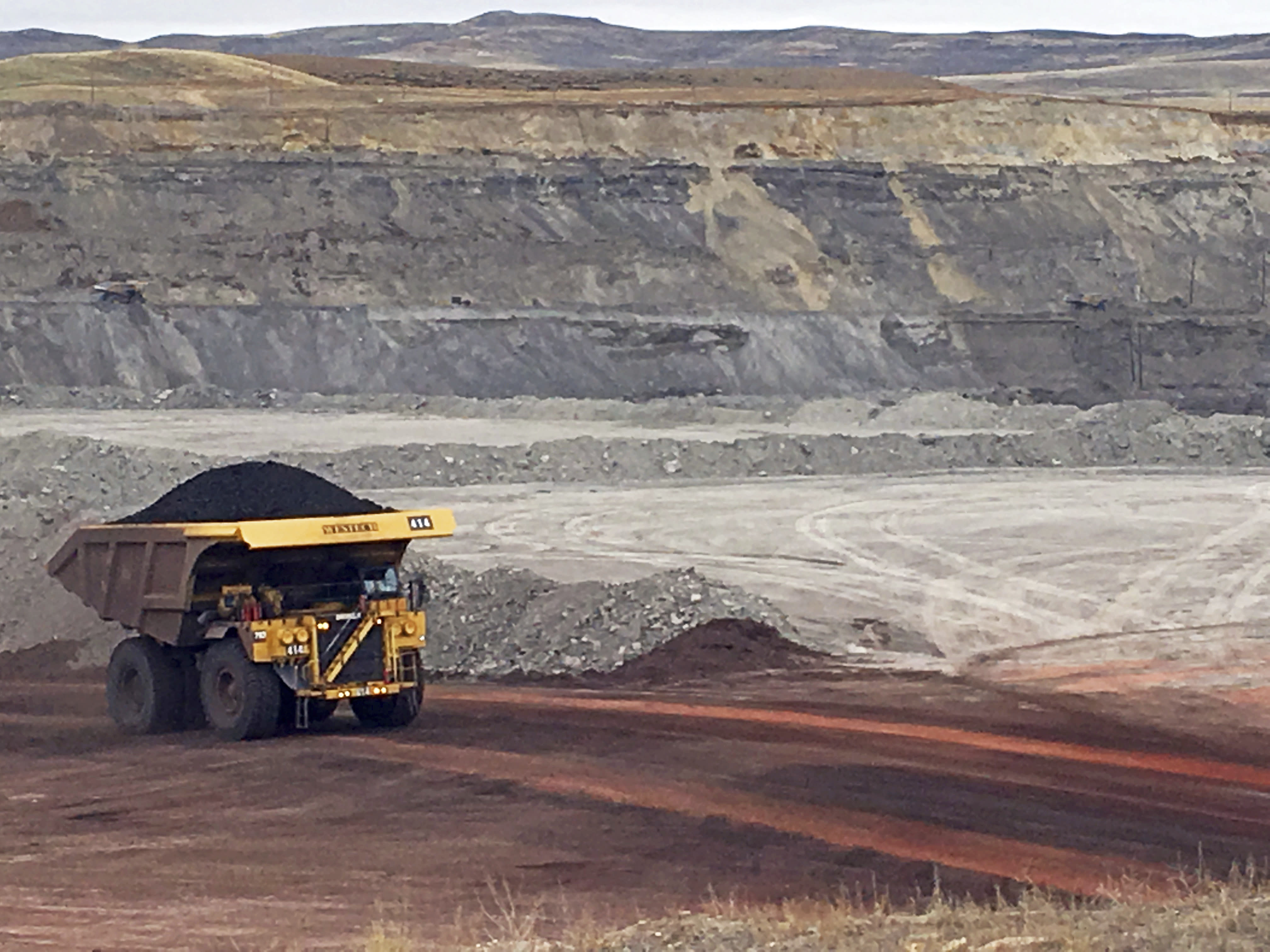 FILE - In this March 28, 2017, file photo, a dump truck hauls coal at Contura Energy's Eagle Butte Mine near Gillette, Wyo. Contura Energy has made a successful bid at auction of $33.75 million for the assets of the Eagle Butte and Belle Ayr mines in Wyoming and Pax Surface Mine in Scarbro, W. Va. They've been closed since Milton, West Virginia-based Blackjewel LLC filed for Chapter 11 bankruptcy protection July 1. (AP Photo/Mead Gruver, File)