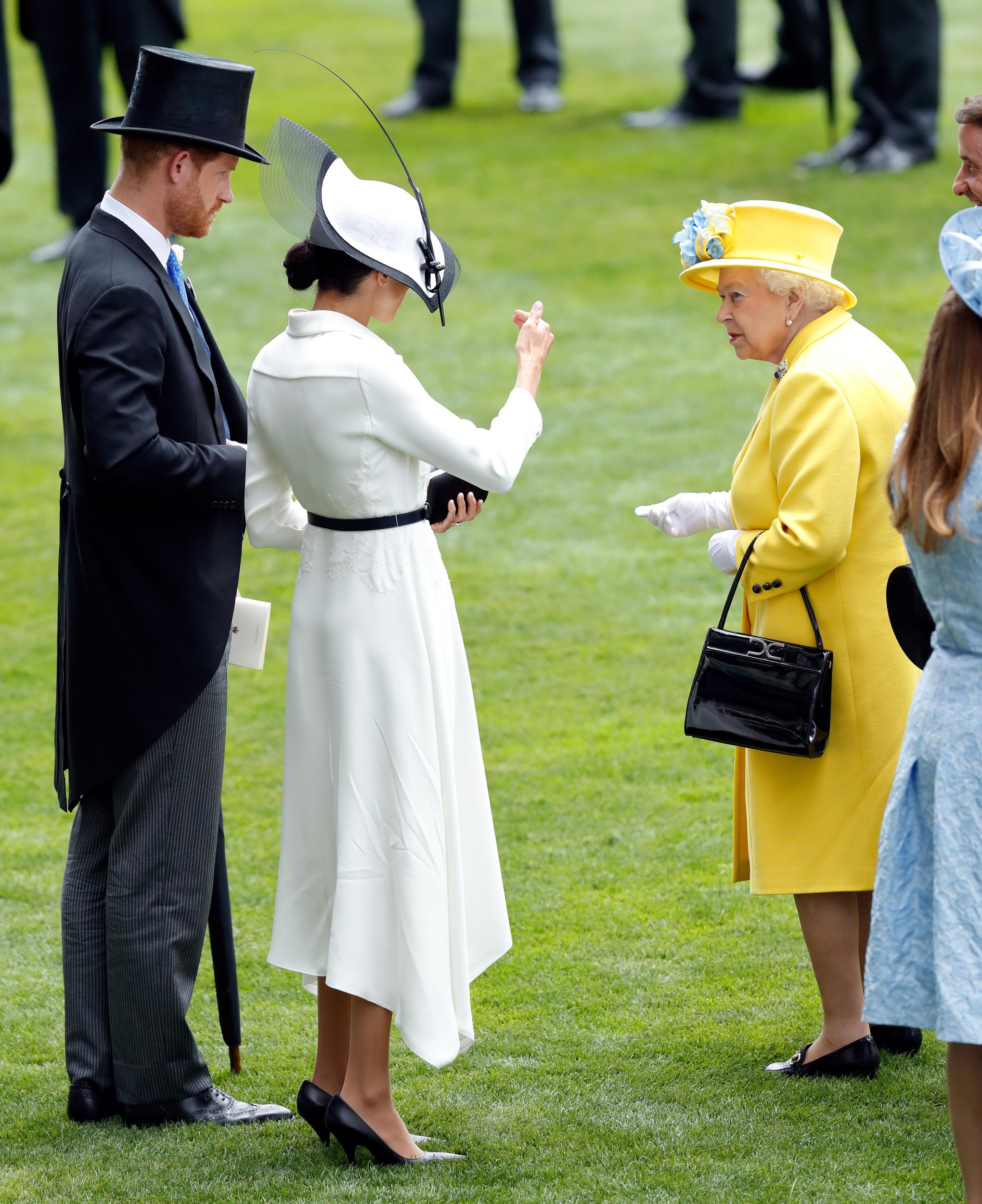 ASCOT, UNITED KINGDOM - JUNE 19: (EMBARGOED FOR PUBLICATION IN UK NEWSPAPERS UNTIL 24 HOURS AFTER CREATE DATE AND TIME) Prince Harry, Duke of Sussex, Meghan, Duchess of Sussex and Queen Elizabeth II attend day 1 of Royal Ascot at Ascot Racecourse on June 19, 2018 in Ascot, England. (Photo by Max Mumby/Indigo/Getty Images)
