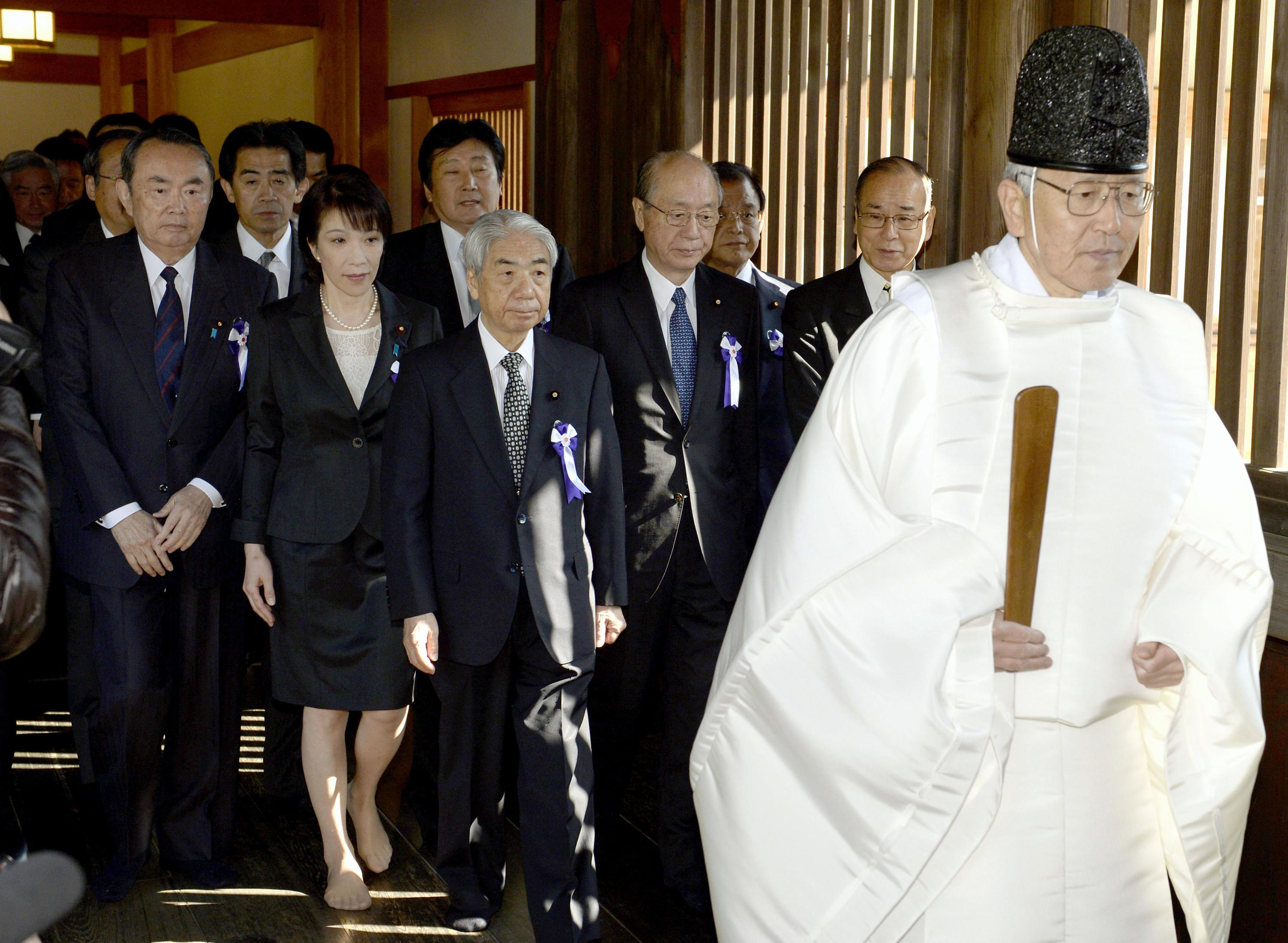 A group of Japanese lawmakers are led by a Shinto priest at the Yasukuni Shrine in Tokyo during an annual spring festival on Tuesday, April 23, 2013. Marking the spring festival, 168 lawmakers paid homage to the controversial war shrine. (AP Photo/Kyodo News) JAPAN OUT, MANDATORY CREDIT, NO LICENSING IN CHINA, HONG KONG, JAPAN, SOUTH KOREA AND FRANCE