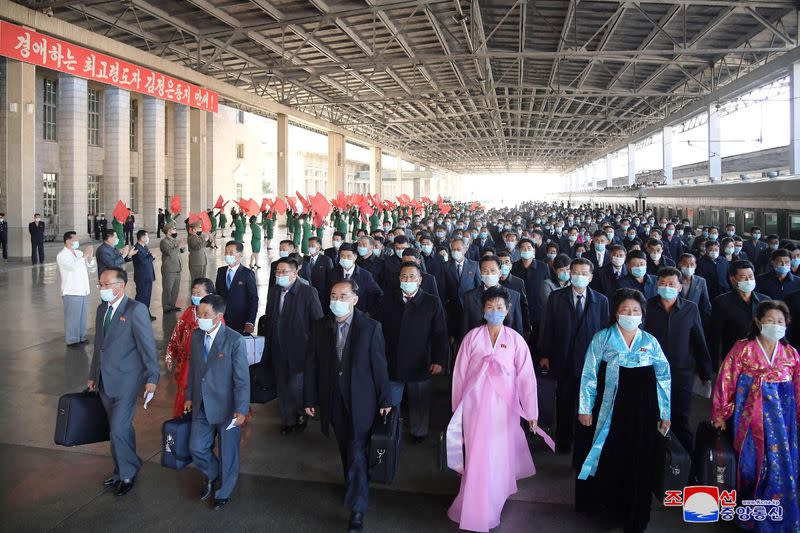 Delegates arrive for the celebrations for the 75th founding anniversary of the WPK at Pyongyang railway station