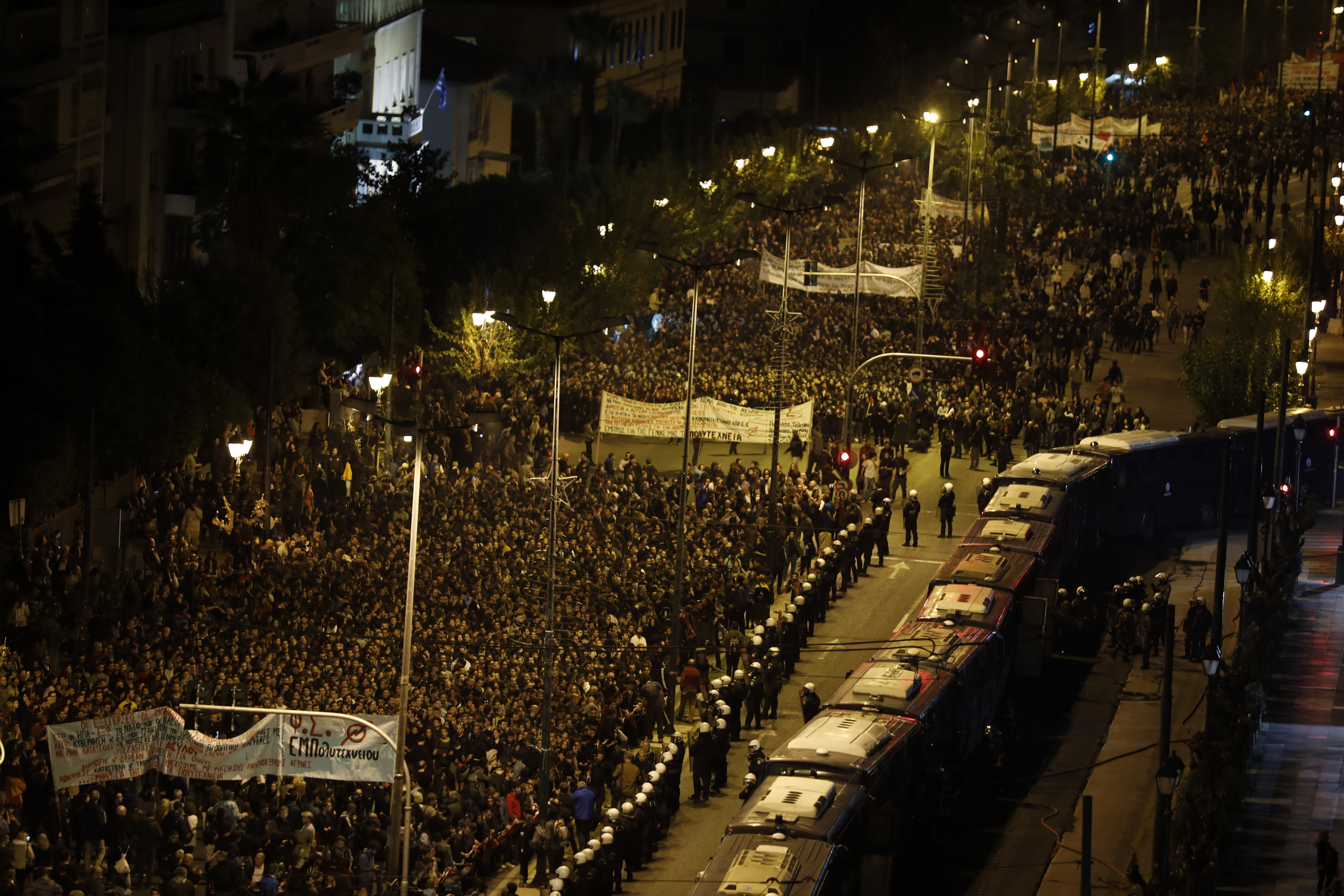 Riot police guard the U.S. Embassy as protesters take part in a rally in Athens, Sunday, Nov. 17, 2019. Several thousands people march to the U.S. Embassy in Athens under tight police security to commemorate a 1973 student uprising that was crushed by Greece's military junta, that ruled the country from 1967-74. (AP Photo/Petros Giannakouris)