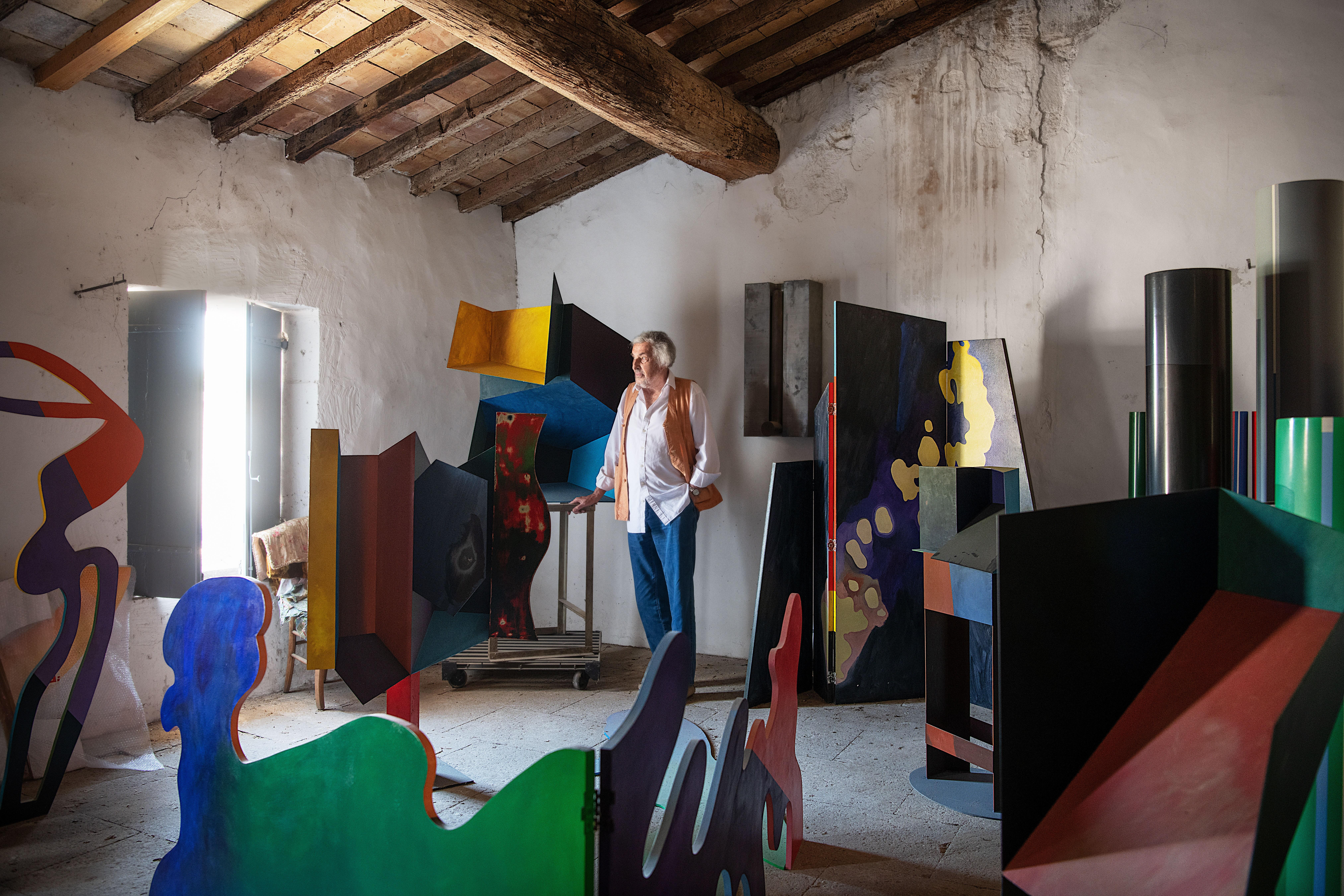 In his attic, Guy de Rougemont is surrounded by his polychrome sculptures.