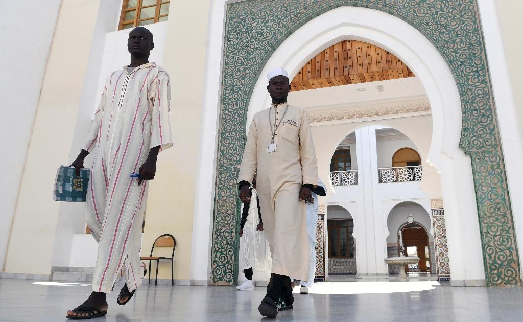 The Mohammed VI Institute in Rabat trains Muslim prayer leaders to preach coexistence and was one of the first stops on Pope Francis's visit to Morocco (AFP Photo/FADEL SENNA)